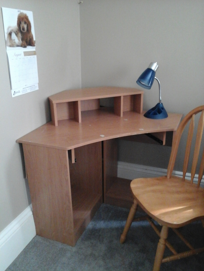 Corner desk with chair, lamp and calendar