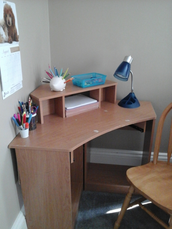 Desk with writing supplies