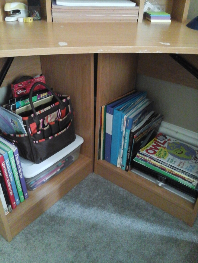 Desk with art supplies and binders