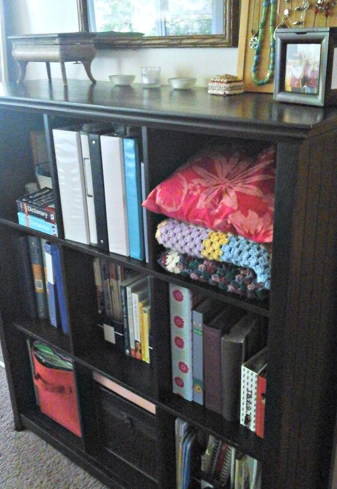 Bookcase linen storage cubby