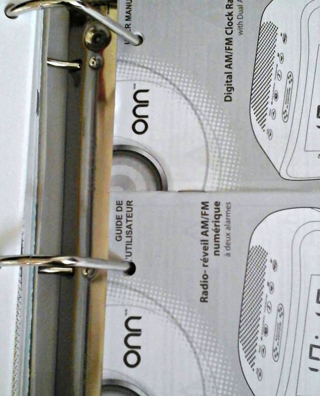 manuals binder hole punched